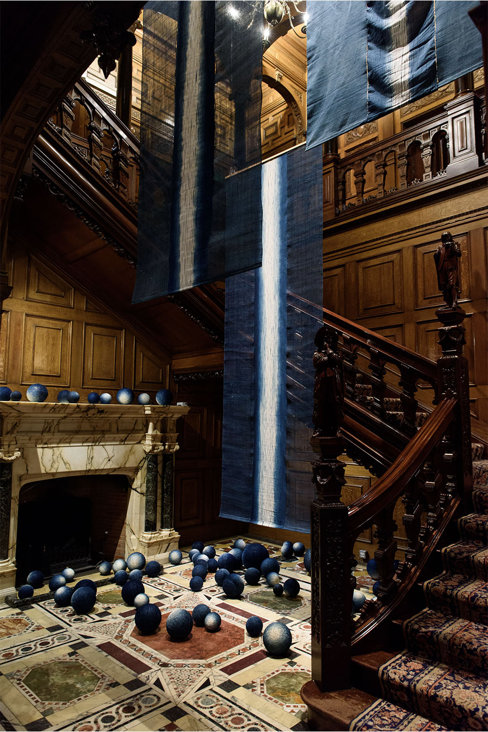 Installation shot of 'Unbound: Visionary Women Collecting Textiles' at Two Temple Place, London
