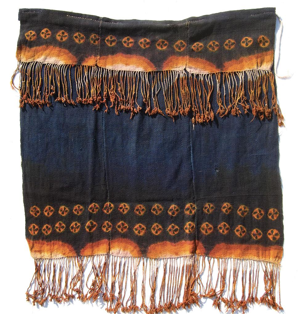 """Zanskari liktse cape, snambu twill with multicoloured fold- and tie-dyed tigma and banded katsar fringe. Wool, 0.91 x 0.81m (3'0"""" x 2'8""""), including fringe"""