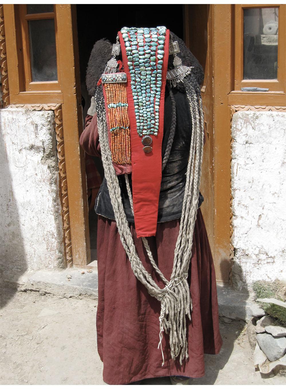 Ladakhi woman wearing a stately perak turquoise headdress and maroon sulma coat, Sham area, Ladakh