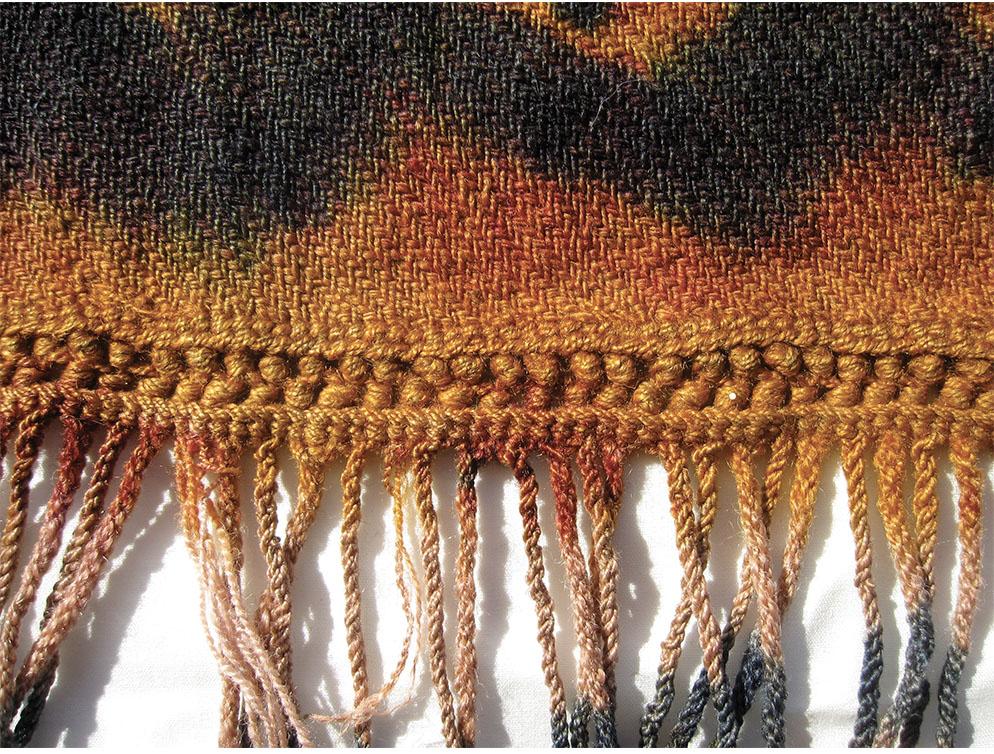 Detail of a Zanskari liktse cape showing the corded warp fringes (katsar)