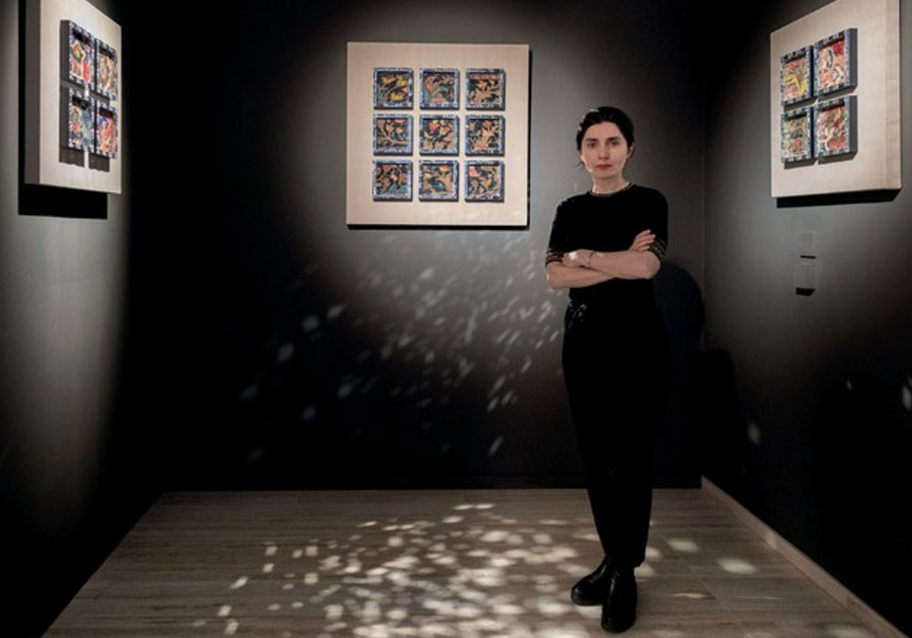 The artist in front of her Mirror Works series (2019-2020) using framed carpet fragments