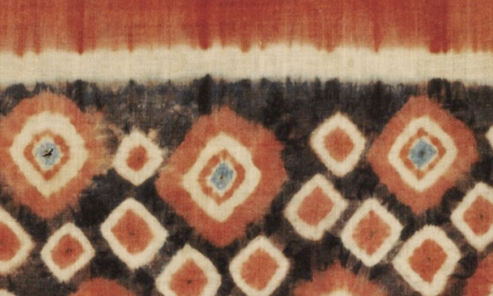 INDONESIA  Toraja pori roto ceremonial banner (detail), Sulawesi, 19th/early 20th century. Thomas Murray, Mill Valley. Plangi, the word used to describe tie-dye patterning throughout Indonesia, means 'rainbow'. In the remote highlands of Sulawesi it was used on handspun locally woven cotton cloth or trade cloth by the Toraja people to create long ceremonial banners hung from bamboo poles or the tall roof peaks of traditional houses, Tongkonan.