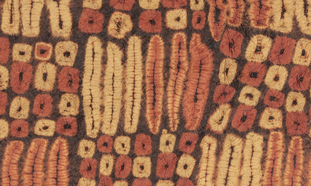 WEST AFRICA  Dida ceremonial skirt (detail), Côte d'Ivoire, 19th or 20th century. Andrés Moraga, Berkeley. In southwestern Côte d'Ivoire, Dida female weavers produced extremely fine linen-like cloths without the use of a loom from raffia-palm fibres which were plaited then dyed with natural pigments using hundreds of stitches to form a resist into dynamic compositions with low-relief sculptural qualities. They were worn as tubular garments and displayed during ceremonial dances by the tribal elite.