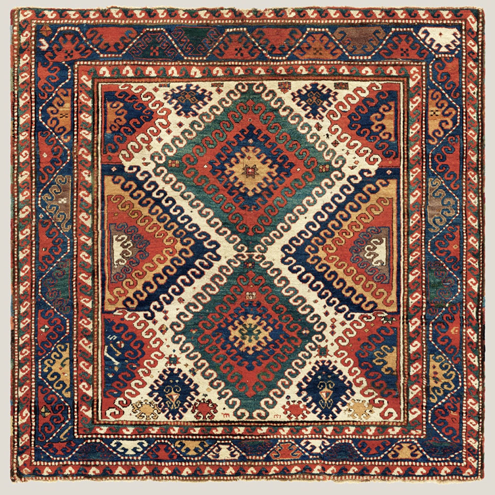 "(6) 'Borjalu' Kazak rug, western Transcaucasus, 19th century. Warp: Z3S uniform ivory/beige wool; weft: two singles, dark red wool, two to eight shoots, mostly three to four; knots: symmetric, V6-8.5 x H6-7 = average 47/in2 (ca. 735/dm2), pile height about 12 mm; sides: two pairs of reinforced warps interlaced with 3-15 cm sections of multicoloured wool; ends: warp finishes missing; top barber's pole border missing, remnants of rose wool plainweave at the bottom; colours: 8: red, ivory, medium blue, blue green, abrashed beige/ gold/butterscotch, dark blue, aubergine (partly corroded), dark brown (corroded); 196 x 201 m (6' 5"" x 6' 7""). Author's collection, published Tschebull, Kazak, 1971, pl.23 (b/w only); Qarajeh to Quba, 2019, pl.32"