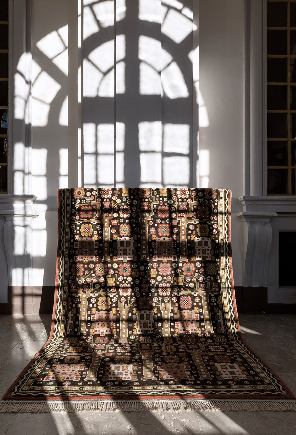 Svarta Trädgårdsmattan, designed in 1923, is often referred to as one of MååsFjetterström's masterpieces. The design was inspired by the ancient oaks in her childhood garden, but also has clear influences from traditional Persian carpets
