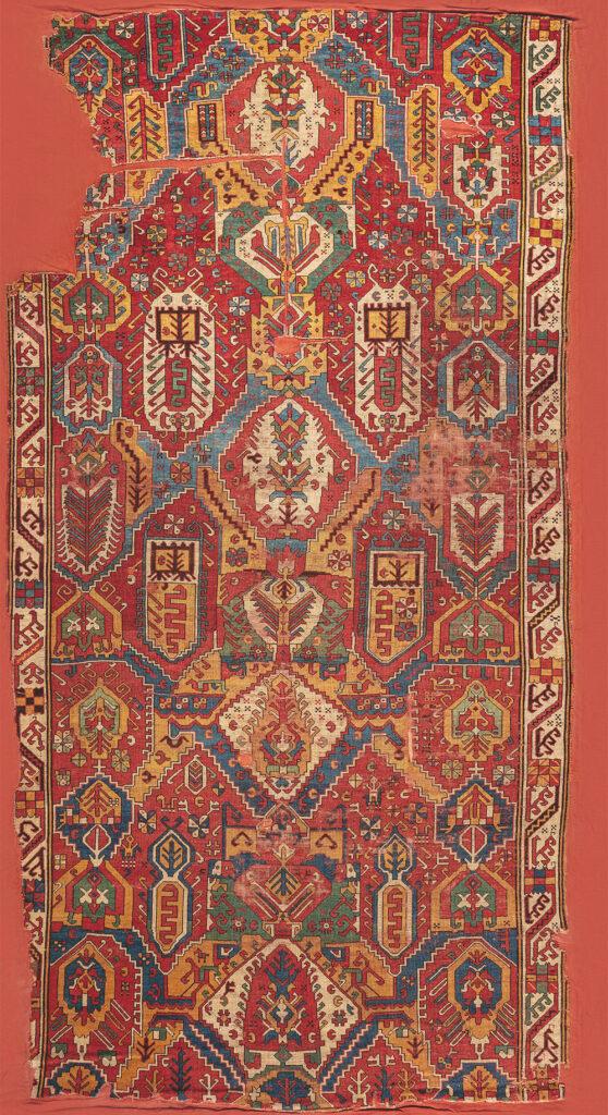"'Dragon' carpet, Azerbaijan, 18th century. Warp: wool, Z2S; bottom weft: wool, red, 2Z; top weft: wool, red, 2Z; pile: wool, 2Z, h. 2-3 mm; symmetric knot, density: 34 x 34 sq.dm; 2.01 x 3.84 m (6' 7"" x 12' 7""). TIEM, Istanbul, inv. no. 97"