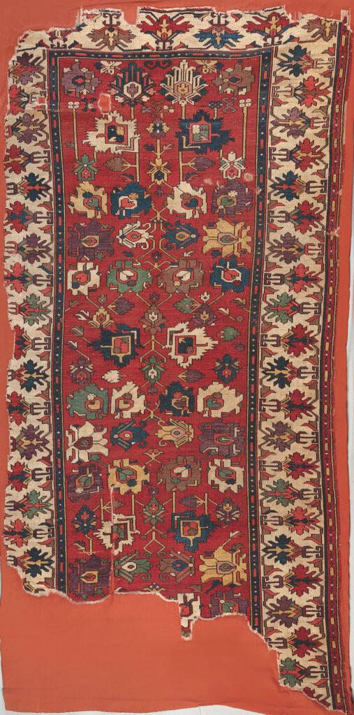 "'Afshan' carpet, Azerbaijan, 18th century or earlier. Warp: wool, Z2S; bottom weft: wool, red, Z2S; top weft: wool, red, Z2S; pile: wool, 2Z, h. 2-3 mm ivory; symmetric knot, density: 24 x 40 sq.dm, 1.50 x 3.08 m (4' 11"" x 10 1""). TIEM, Istanbul, inv. no. 860"