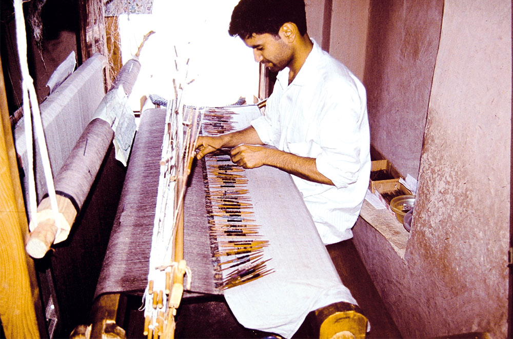 Manzoor Ahmed Sheikh, brother of one of the best kani master weavers, on his loom