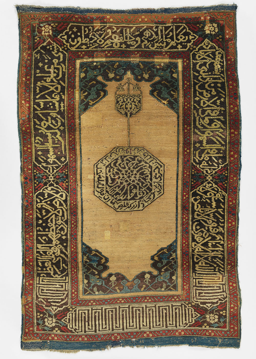 "Rug with pseudo-kufic inscriptions, attributed to Turkey, 17th century. Wool, symmetrically knotted, 1.04 x 1.63 m (3' 5"" x 5' 4""). The Met, 22.100.123, The James F. Ballard Collection, Gift of James F. Ballard, 1922"