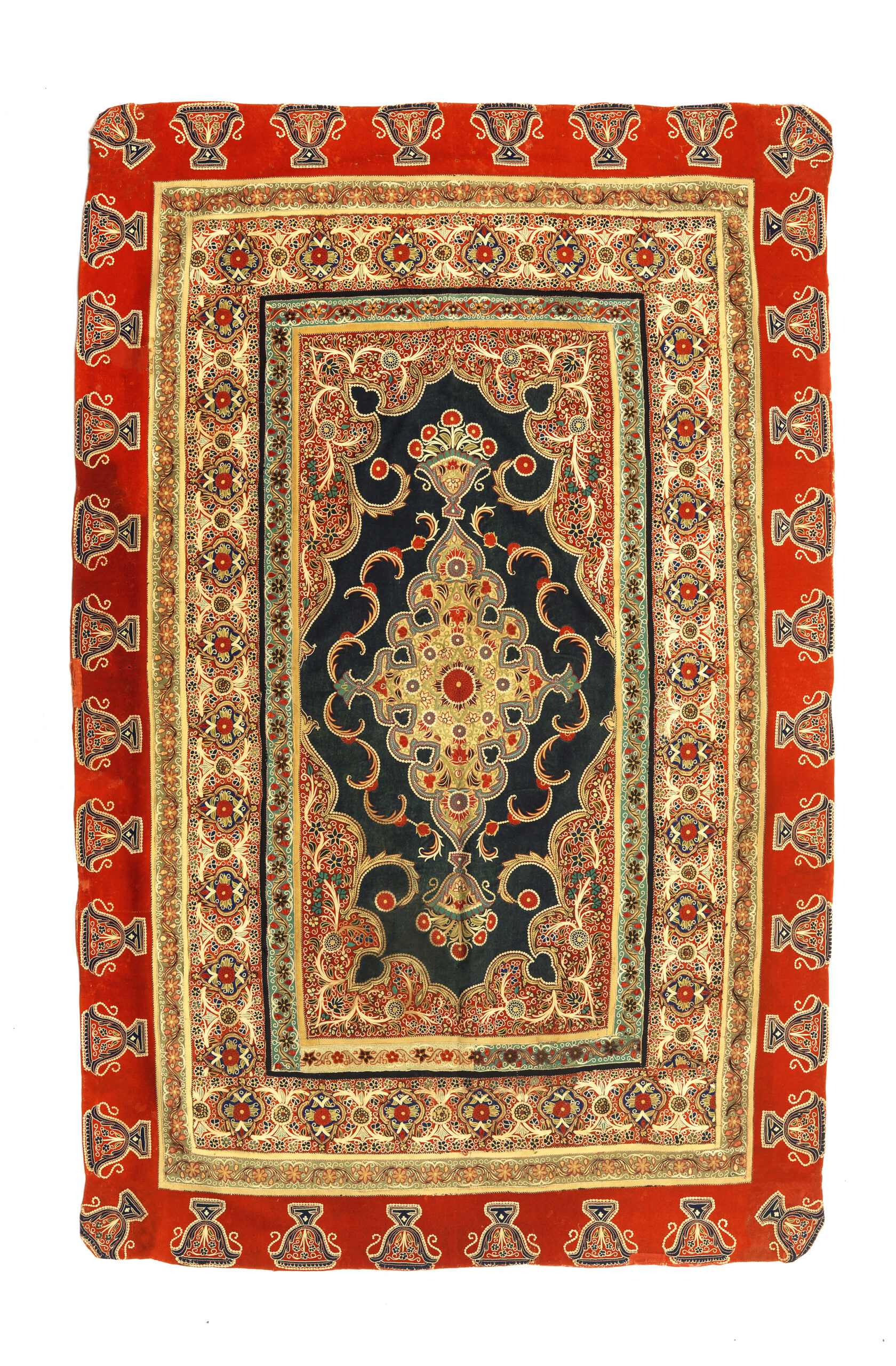 4 Cover, Rasht, late 19th century. Rasht-duzi patchwork, red, blue and yellow wool flannel embroidered in fine stitches with flower and foliage medallions and borders