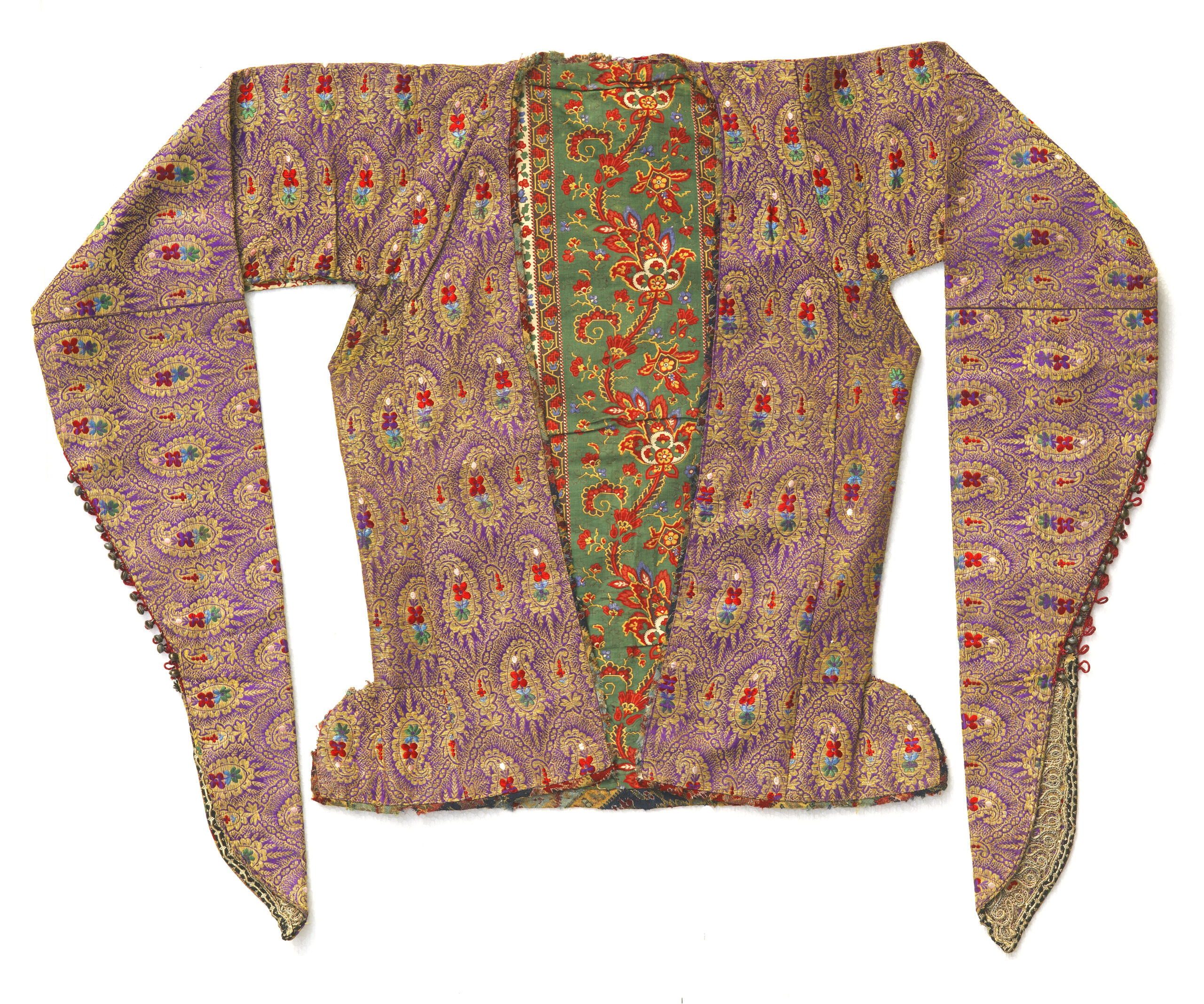 1 Woman's jacket, Esfahan, Iran, mid-19th century. Zarbaft silk woven with a design of repeated boteh motifs and a printed cotton lining imported from Russia or England. Silk, gold thread, sleeve ends with tiny buttons, trimmed with gold lace. All images, The Ramezani Family Collection