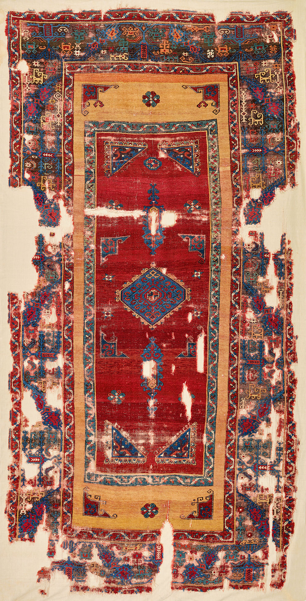 """1-2 'Field within field' design carpet with a 'fabulous creatures' border (and border detail), west Anatolia, ca. 1475–1525. Wool pile on a wool foundatio1n, 1.71 x 3.43 m (5' 7"""" x 11' 3""""). Kirchheim Family Collection, Hannover. Published Orient Stars, Stuttgart, 1993, pl.197. The author has personally examined all but one of the carpets illustrated in this article"""