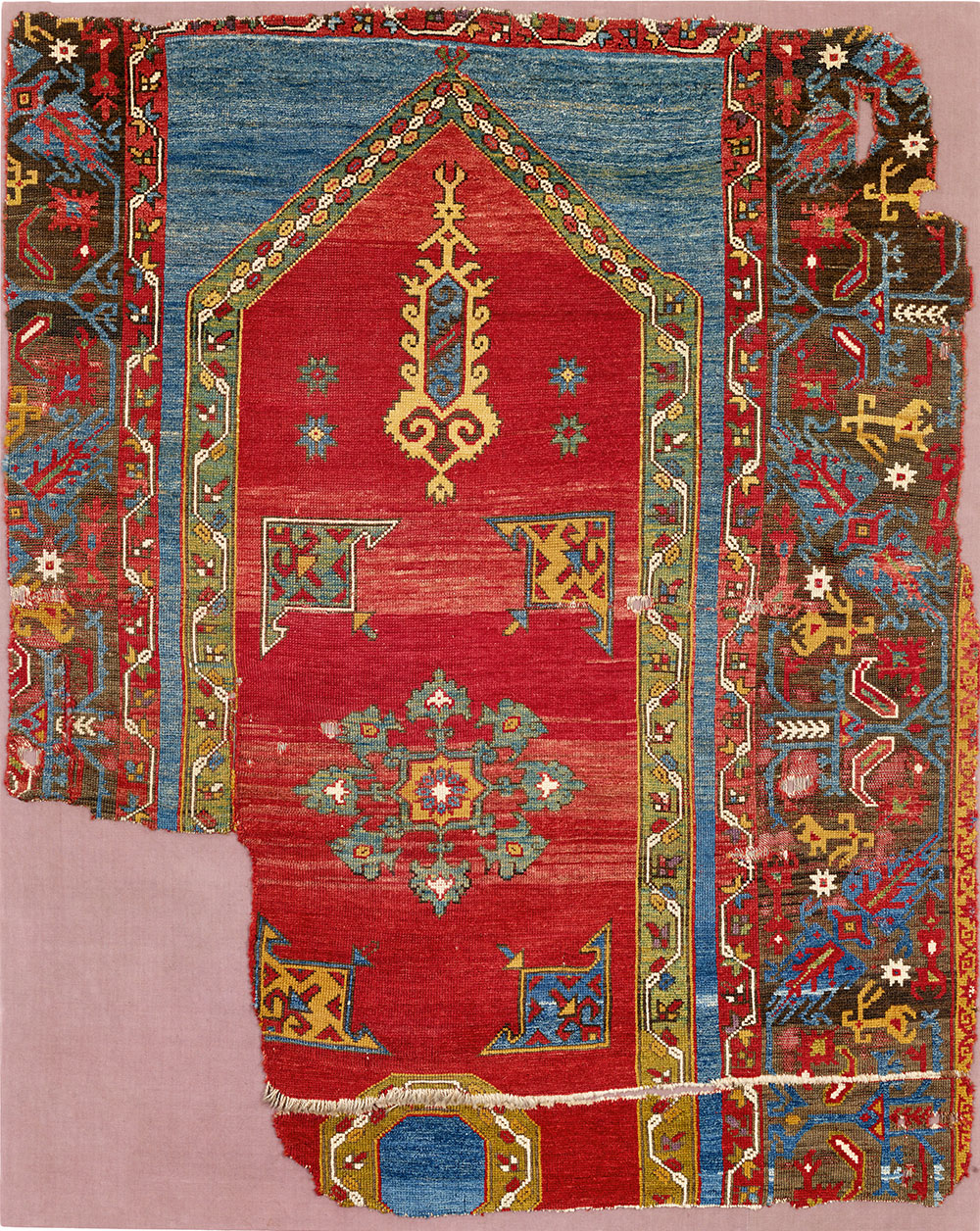 """'Bellini' keyhole niche rug fragment (and border detail), west Anatolia, ca. 1525–75. Wool pile on a wool foundation, 1.32 x 1.62 m (4' 4"""" x 5' 4""""). Kirchheim Family Collection, Hannover. Published Orient Stars, Stuttgart, 1993, pl.189"""