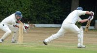 Warick-Bradfield-takes-one-behind-the-stumps