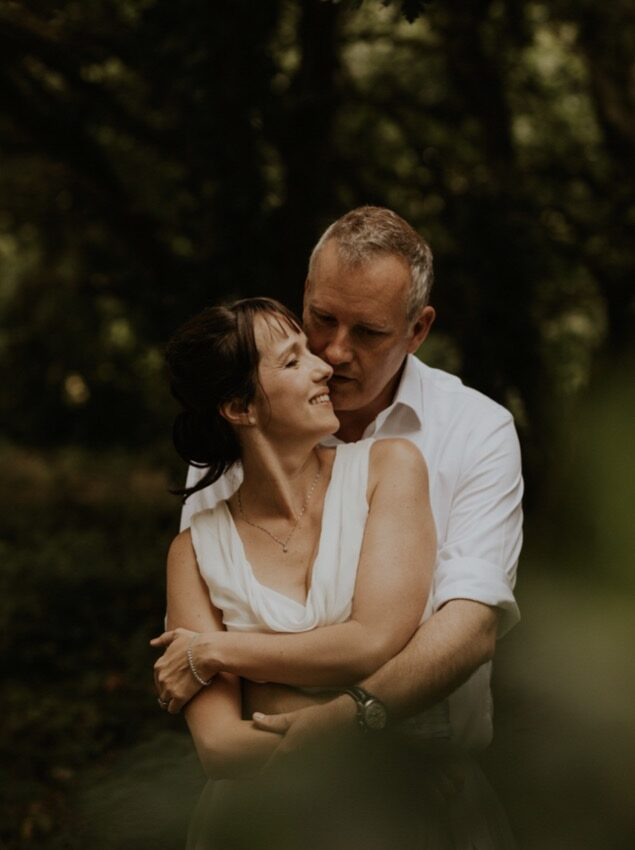 couple in woods wedding shot