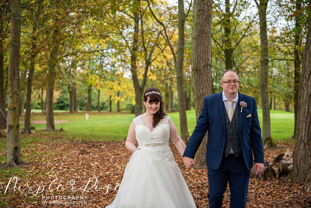Couple walking during their autum wedding