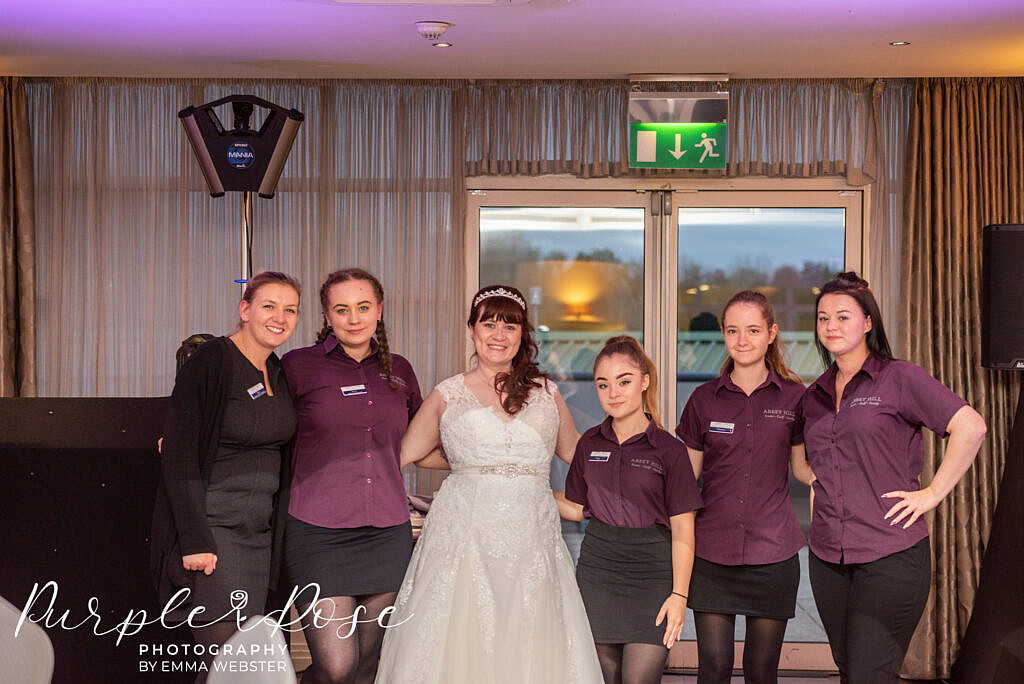 Bride standing with her wedding venues staff