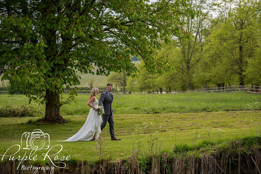 Bride and groom strolling through the gardens