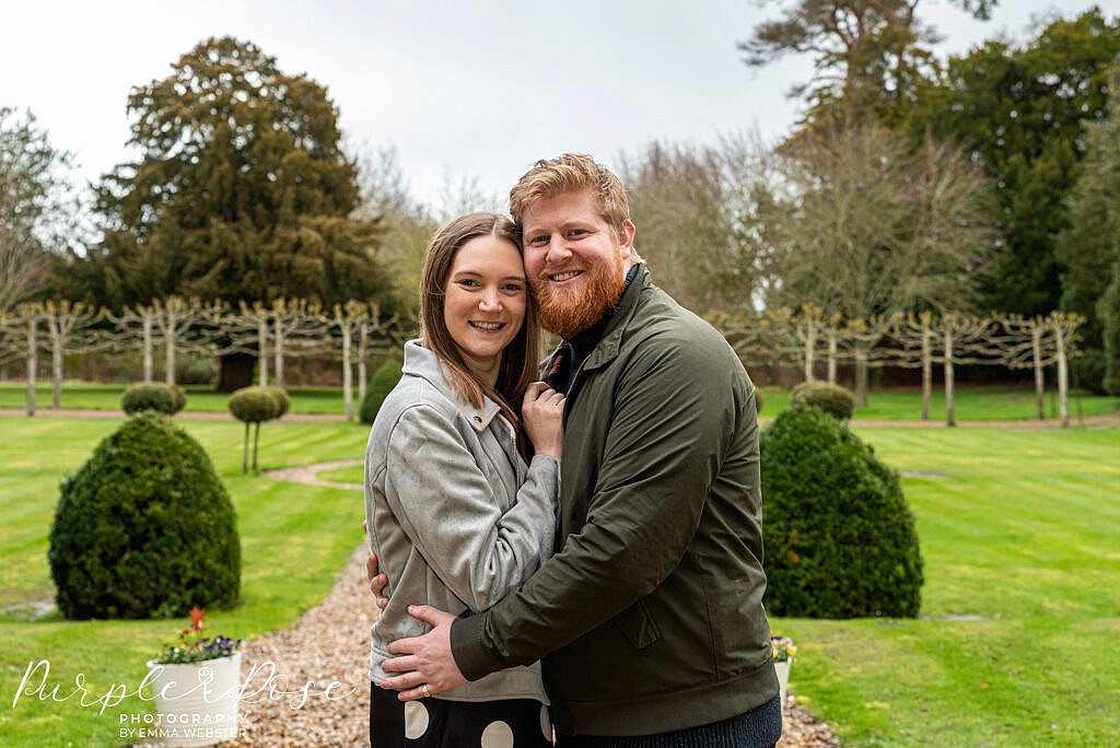 Couple embracing in a well kept garden