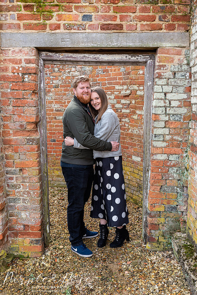 Couple standing in a doorway