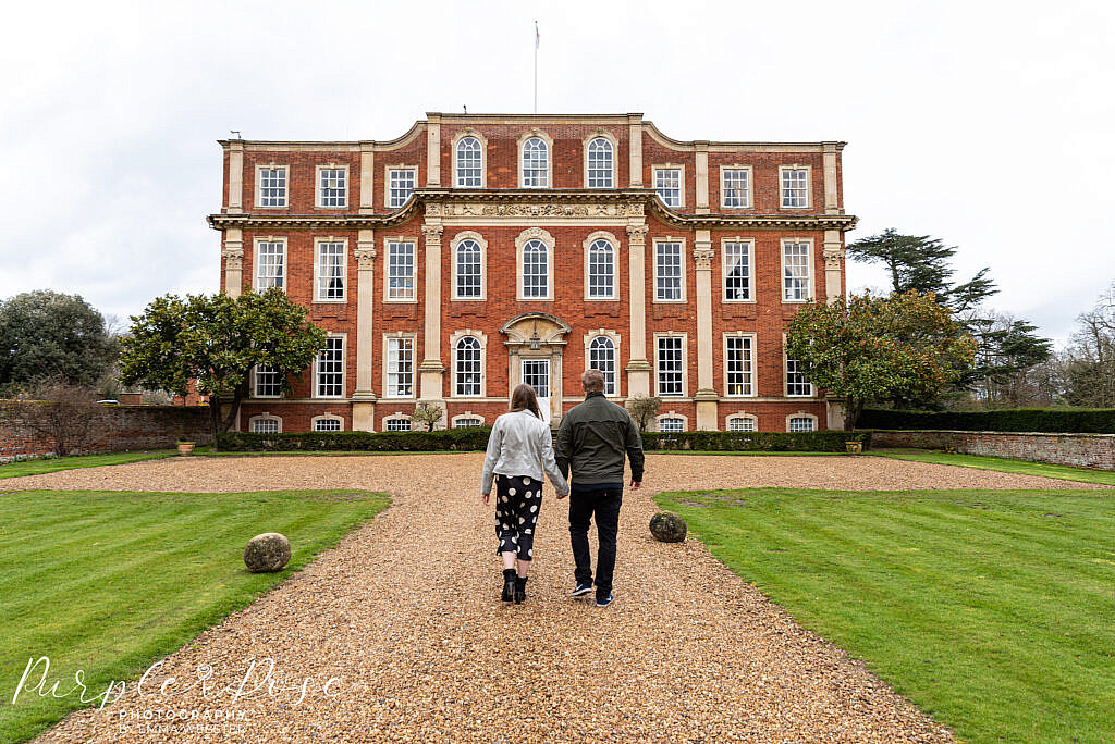 Couple walking towards Chicheley Hall