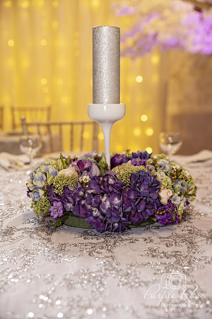 Purple flowers and candle centre piece