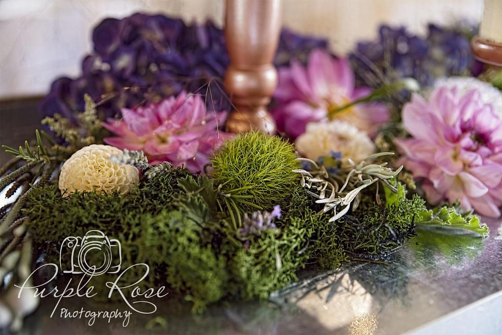 Flowers surrounding wedding cake