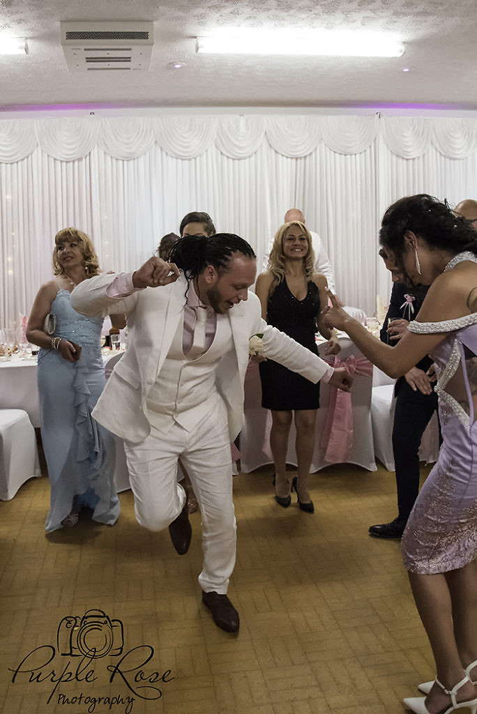 Groom dancing at his wedding reception