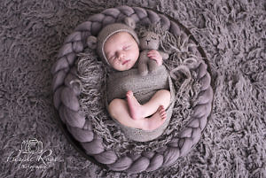 Newborn baby sleeping in a bowl