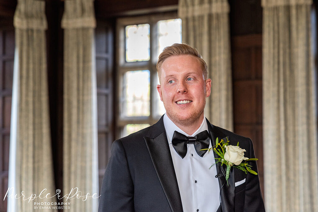 Groom waiting for his bride in the ceremony room