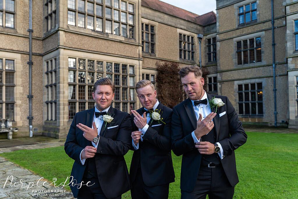 Groom posing with his groomsmen