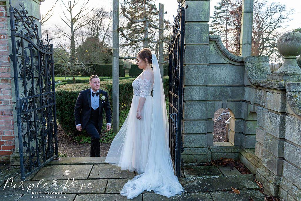 Groom walking to his bride