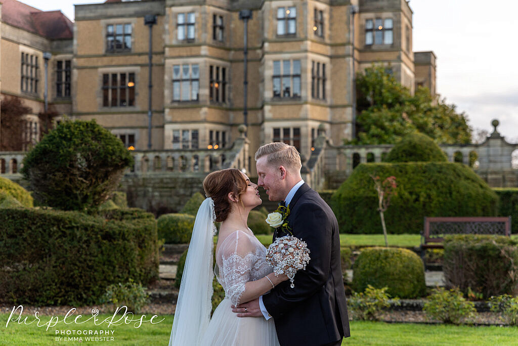 Bride and groom outside their wedding venue