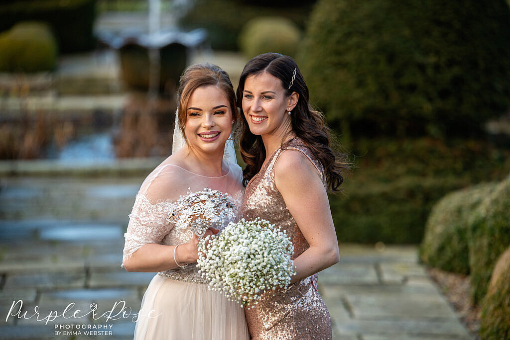 Bride smiling with her bridesmaid