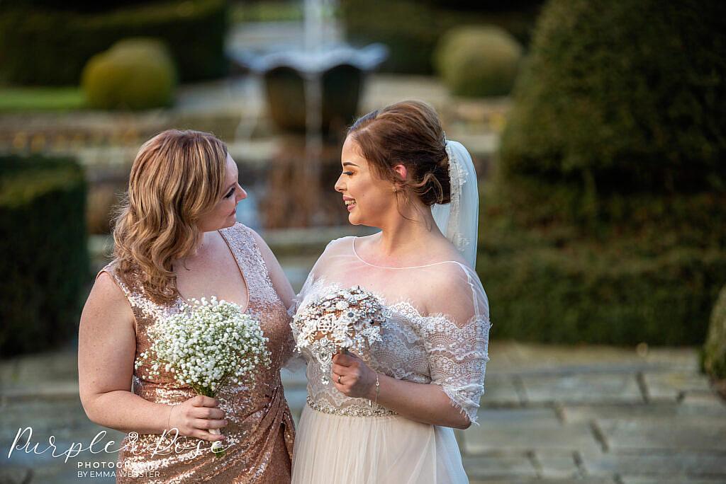 Bride looking at her bridesmaid