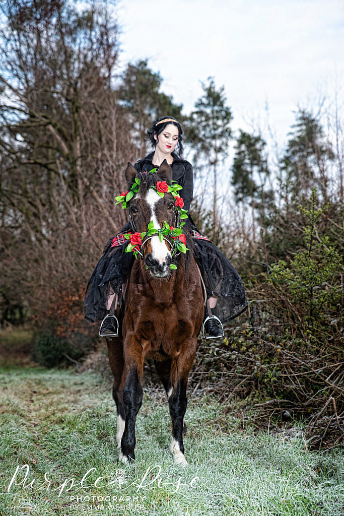 Gothic bride riding a horse