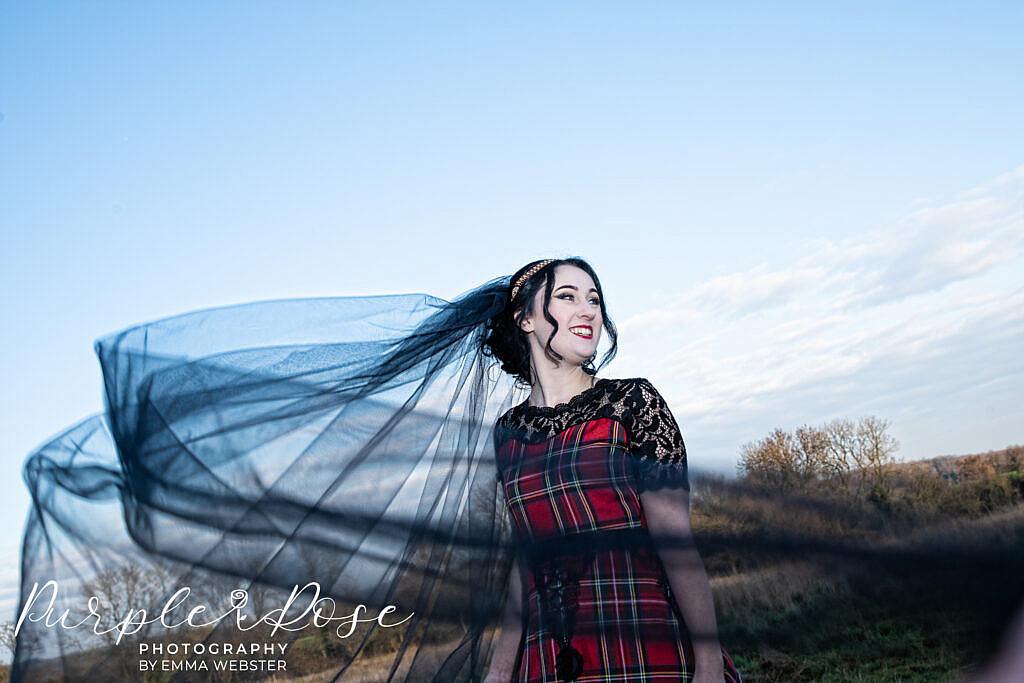Brides black wedding veil swishing
