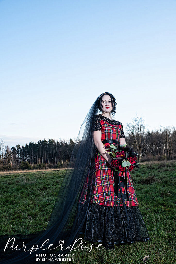 Gothic bride wearing black and red tartan