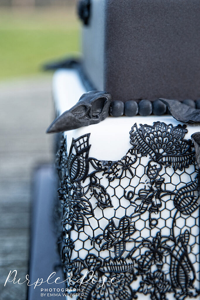 Black lace detail on wedding cake