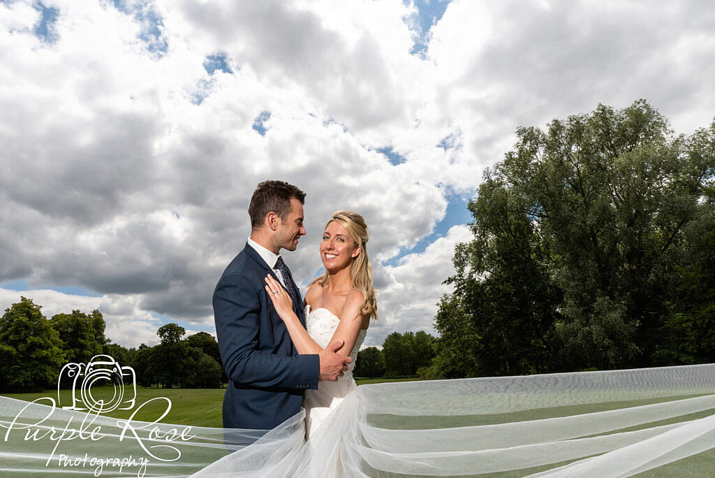 Bride and groom under s dramatic sky