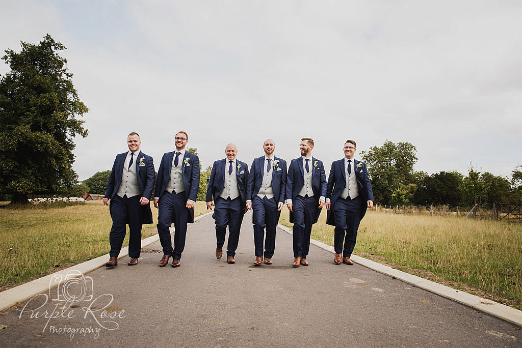 Groomsmen walking to the wedding