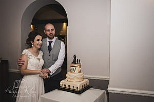 Bride and groom preparing to cut their wedding cake