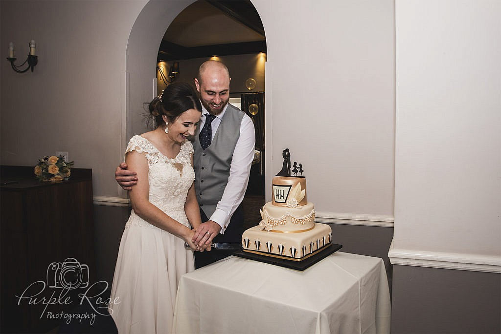 Bride and groom cutting their wedding cake