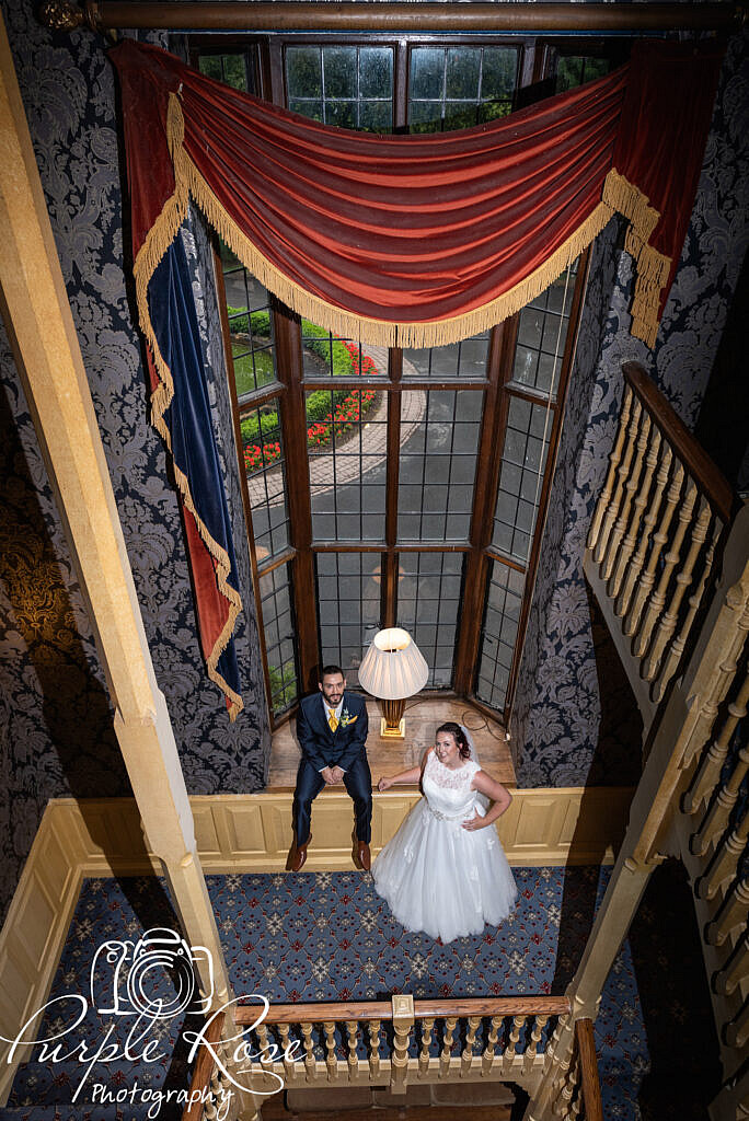 Bride and groom relaxing on a stair case