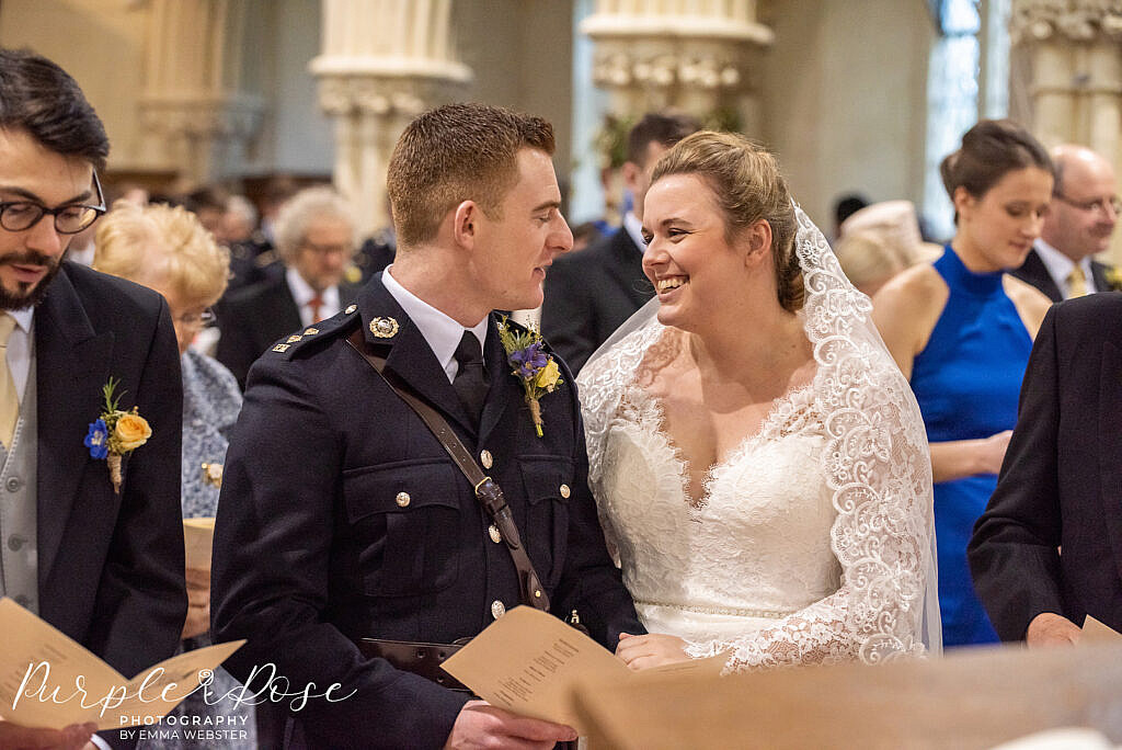 Bride smiling during her church ceremony