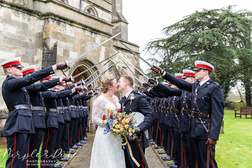 Bride and groom kissing at a military wedding