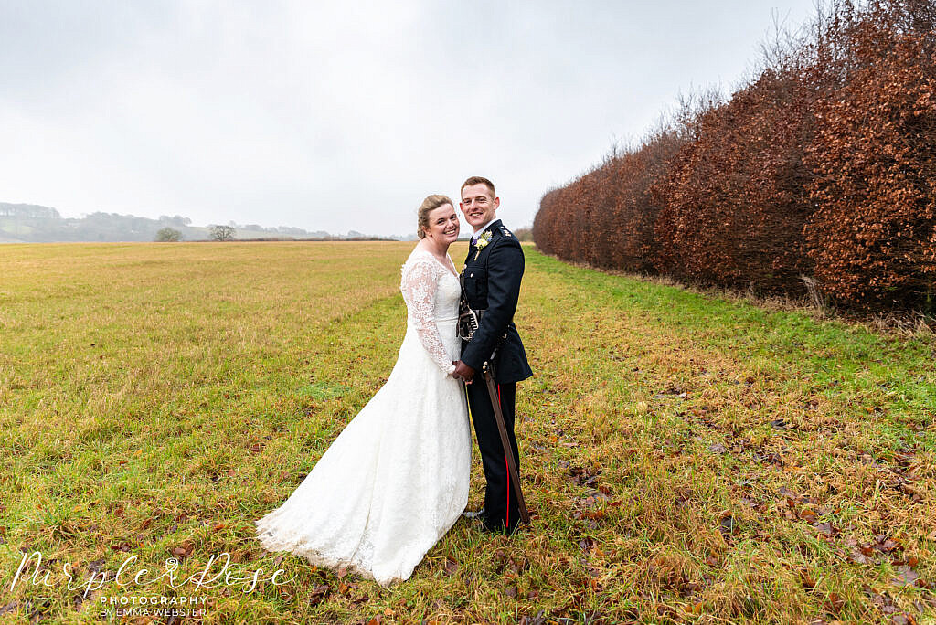 bride and groom in a misty field