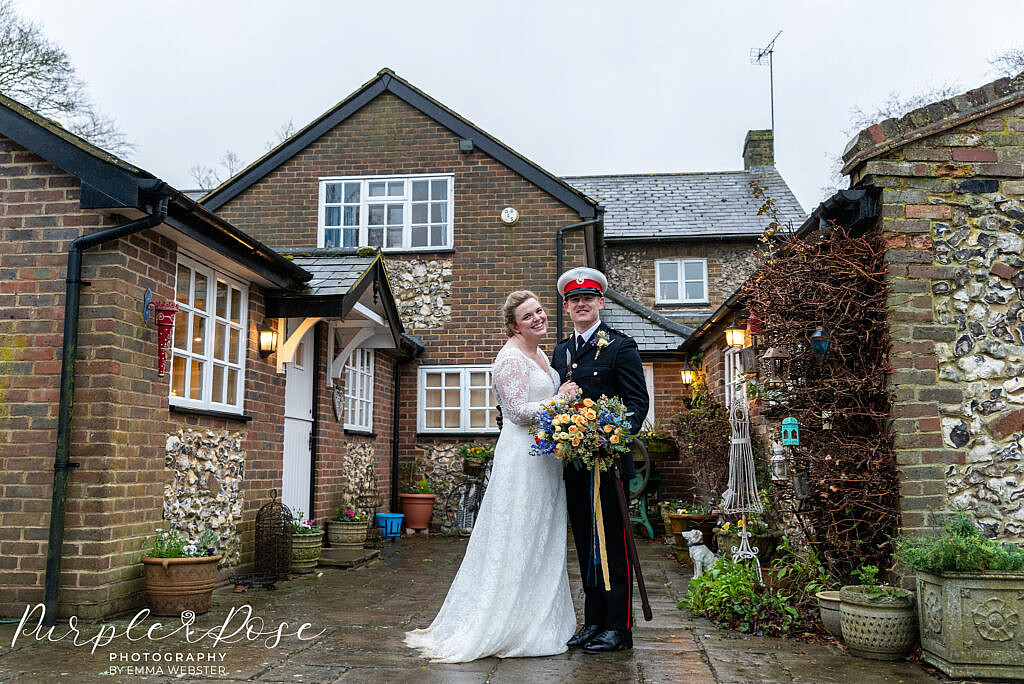 Bride and groom in a courtyard