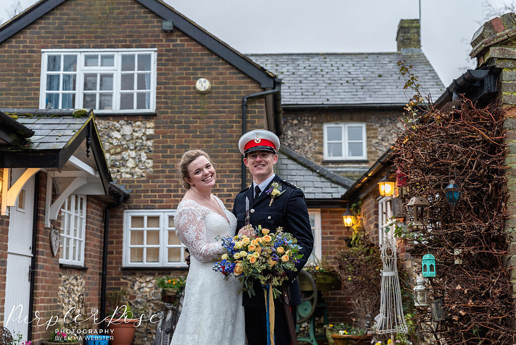 bride and groom embracing in a courtyard