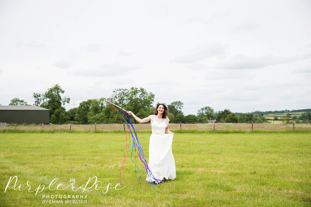 bride playing in a field